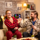 Gamers couple playing video games on the TV with wireless controllers in hands - PhotoDune Item for Sale