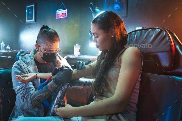 Artist Drawing Tattoo On Client In Parlor - Stock Photo - Images
