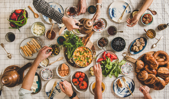 Flat-lay family having traditional Turkish breakfast with black tea - Stock Photo - Images