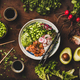 Salmon poke bowl with vegetables, greens, sushi rice, soy sauce - PhotoDune Item for Sale