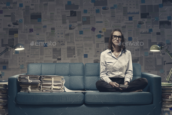 Businesswoman working on the sofa late at night - Stock Photo - Images
