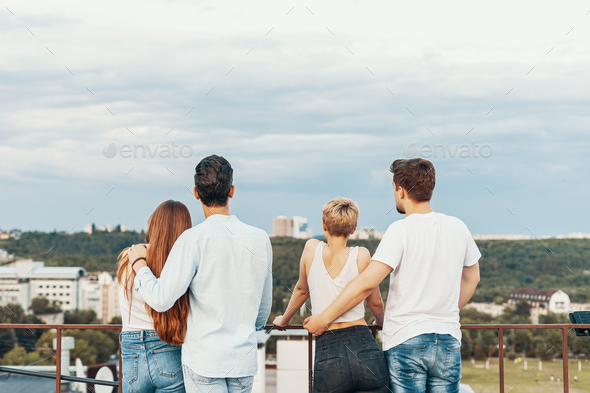Group of friends enjoying outdoors at roof - Stock Photo - Images