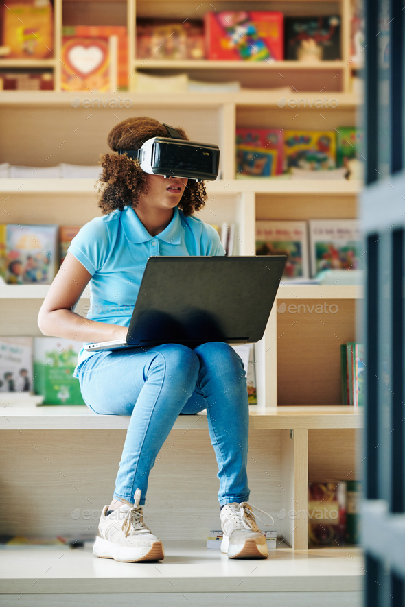 Girl using virtual glasses - Stock Photo - Images