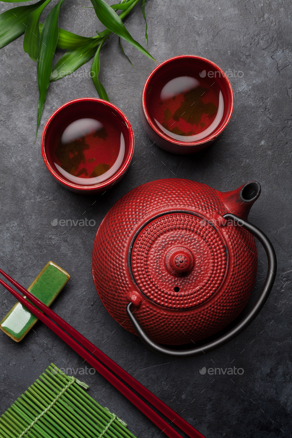 Green tea in bowls and teapot - Stock Photo - Images