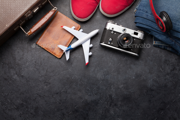 Suitcase, camera, clothes and travel accessories - Stock Photo - Images
