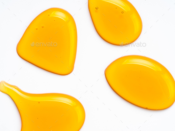 Honey drops abstract pattern, isolated on white - Stock Photo - Images