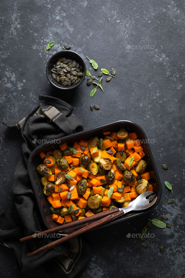 Brussels sprouts baked with butternut squash, top view - Stock Photo - Images