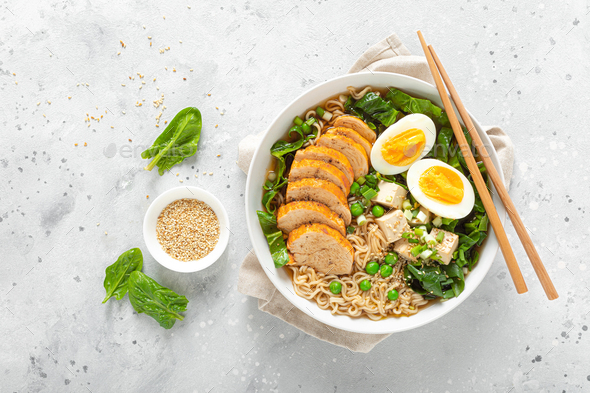 Ramen noodle soup with chicken breast, egg and spinach - Stock Photo - Images