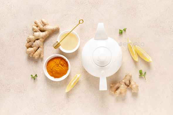 Ginger turmeric tea with honey, fresh lemon and mint - Stock Photo - Images