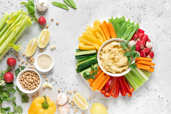 Hummus with fresh vegetables, healthy vegetarian food concept, top view - Stock Photo - Images