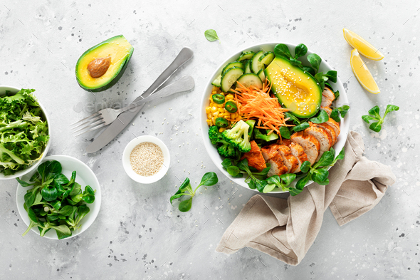 Buddha bowl with grilled chicken breast, avocado and fresh vegetable salad for lunch - Stock Photo - Images