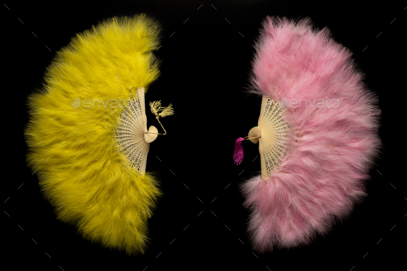 Yellow and pink Chinese folding fan on a black background - Stock Photo - Images