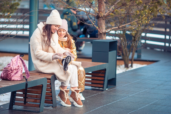 Family winter sport. Mother and daughter on winter day - Stock Photo - Images