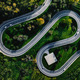 Aerial view of winding curved road with helicopter parking in Italy - PhotoDune Item for Sale