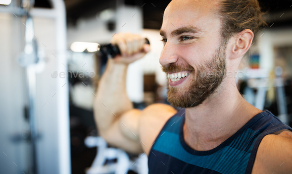 Fitness, sport, exercising and lifestyle concep Young man working out in gym - Stock Photo - Images