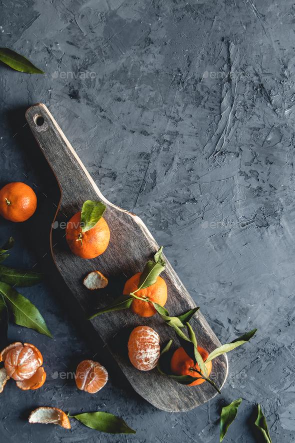 Fresh orange mandarin on wooden cutting board. eco vegetarian. PNOV2019 - Stock Photo - Images