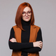 Portrait of smiling red-haired business woman in glasses posing looking at camera - PhotoDune Item for Sale