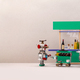 Funny robot waiter carries a cart with alcohol, wine bottles and dishes for two robots - PhotoDune Item for Sale
