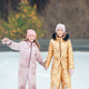 Adorable girls skating on ice rink outdoors in winter snow day - PhotoDune Item for Sale