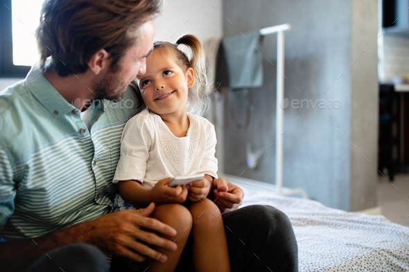 Father and daughter spending time together at home - Stock Photo - Images