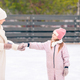 Little adorable girl with her mother skating on ice-rink - PhotoDune Item for Sale