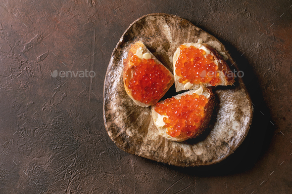 Red caviar with bread and butter - Stock Photo - Images