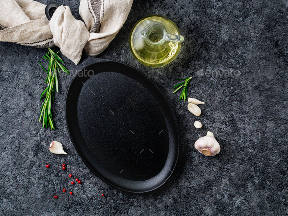 empty oval cast iron frying pan on dark grey concrete background, top view, blank space for text - Stock Photo - Images