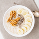 healthy breakfast - oatmeal with nuts, bananas, chia, top view - PhotoDune Item for Sale