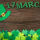 Happy Saint Patrick's mockup of handmade felt hat and shamrock clover leaves on wooden background. - PhotoDune Item for Sale