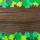 Happy Saint Patrick's mockup of handmade felt shamrock clover leaves on wooden background. - PhotoDune Item for Sale
