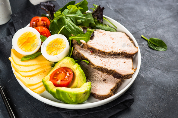 Keto diet plate on black stone table - Stock Photo - Images