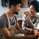 Beautiful young couple cooking healthy food together at home. Having fun in the kitchen - PhotoDune Item for Sale