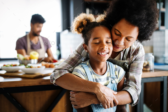 Happy mother and children in the kitchen. Healthy food, family, cooking concept - Stock Photo - Images