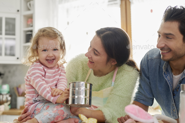 Cheerful family baking together in the kitchen - Stock Photo - Images