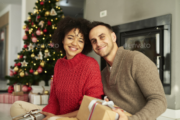 Portrait of affectionate couple ready for Christmas - Stock Photo - Images