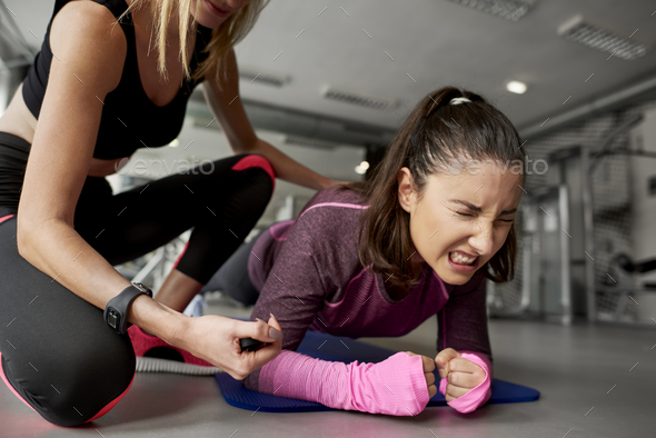 Young woman during hard workout at gym - Stock Photo - Images