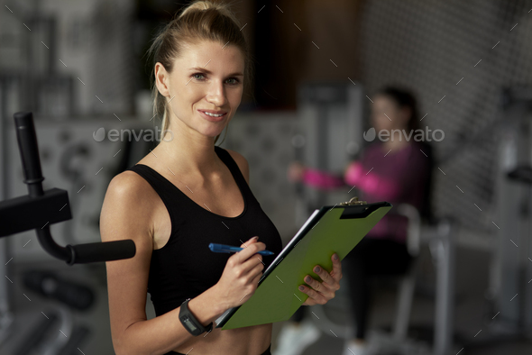 Portrait of female fitness instructor at the gym - Stock Photo - Images