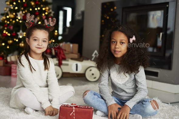 Portrait of two happy girls at Christmas - Stock Photo - Images