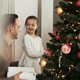 Girl and daddy decorating the Christmas tree - PhotoDune Item for Sale