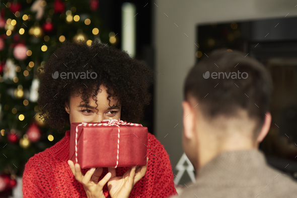 African woman giving the Christmas gift - Stock Photo - Images