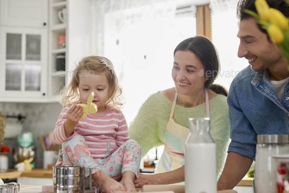 Parents and their little girls in the kitchen - Stock Photo - Images