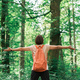 Female hiker with wide spread hands in forest - PhotoDune Item for Sale
