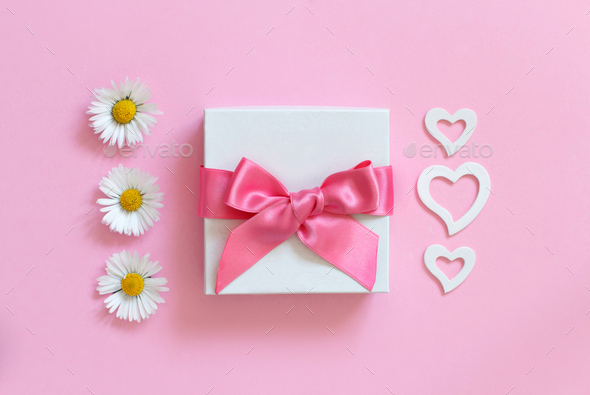 White gift box, daisies and hearts on a light pink background - Stock Photo - Images