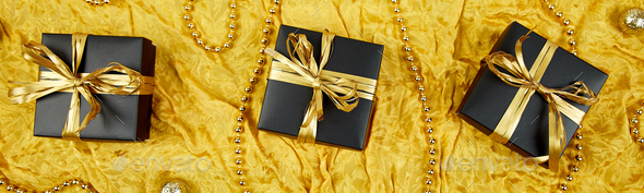 Banner with Luxury black gift boxes with gold ribbon - Stock Photo - Images