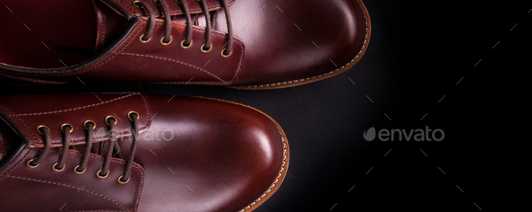 Banner with Brown oxford shoes on black background. Top view. - Stock Photo - Images