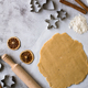 Cooking Christmas gingerbread cookies on a gray background - PhotoDune Item for Sale