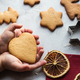 The child is holding a heart-shaped gingerbread in his hands - PhotoDune Item for Sale