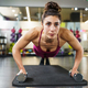 Woman doing push-ups exercise with dumbbell in a fitness workout - PhotoDune Item for Sale