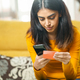 Woman shopping with smartphone paying with her credit card - PhotoDune Item for Sale
