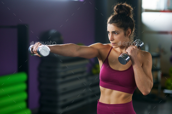 Sporty woman punching and boxing with dumbbells - Stock Photo - Images
